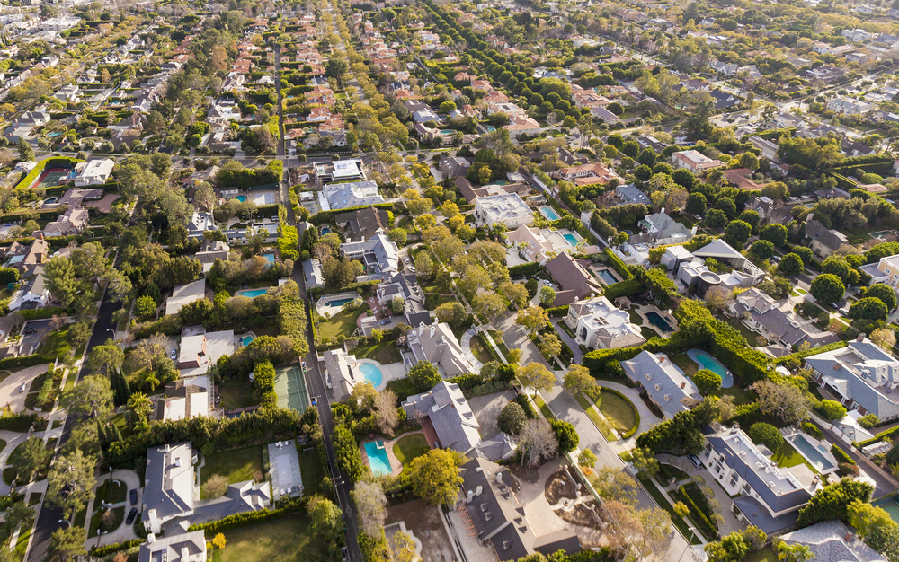 Lawns and pools dot the backyards of homes in Hollywood. Southern California water use rose in February, leading to the state's worst conservation performance yet.